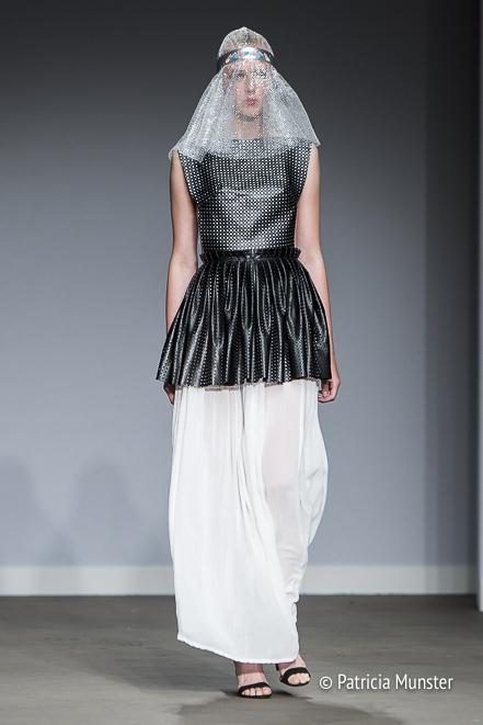 Black 'armour' with white skirt by Maaike van den Abbeele at Fashionweek Amsterdam