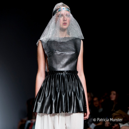 Black 'armour' with white skirt by Maaike van den Abbeele at Fashionweek Amsterdam